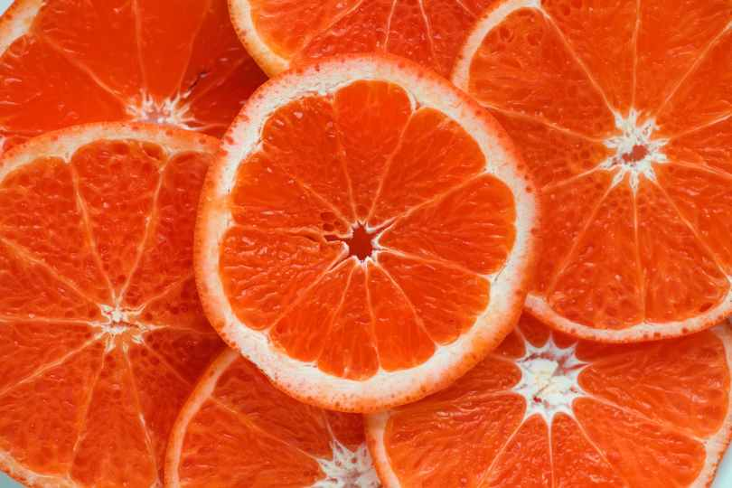 close up photograph of slices orange citrus fruits