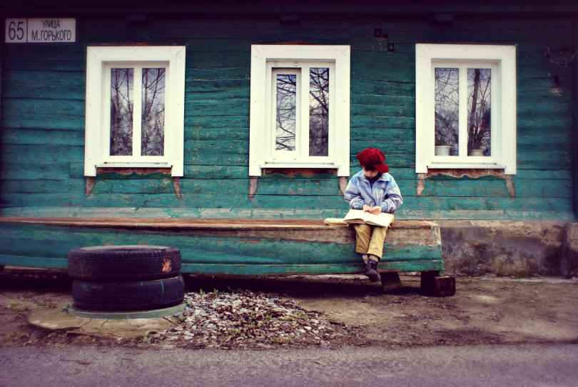 boy seating on bench
