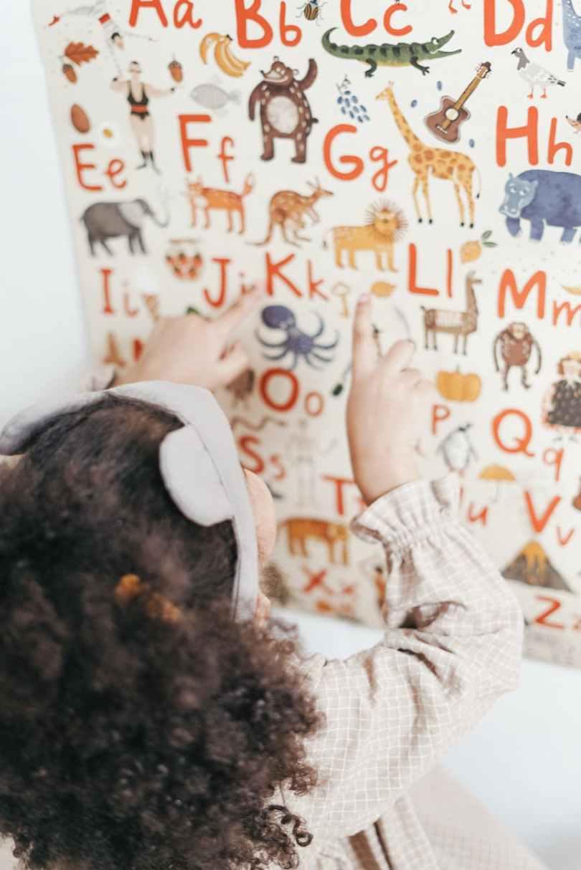 child reading english alphabet