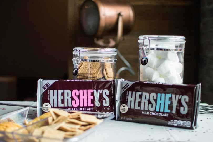 close up photo of hershey s bars near jars