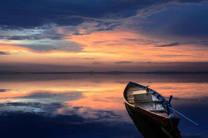 photo of wooden boat on sea